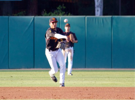 Dante Flores throws to first. (Photo: Shotgun Spratling)