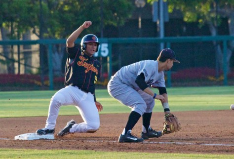 Frankie Rios slides into third base. (Photo: Shotgun Spratling)