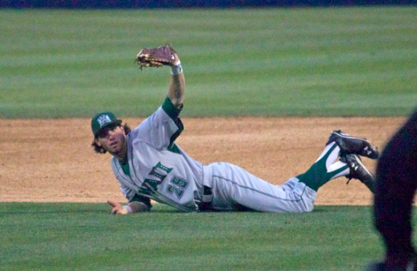 Marc Flores shows the ball after a diving catch. (Photo: Shotgun Spratling)