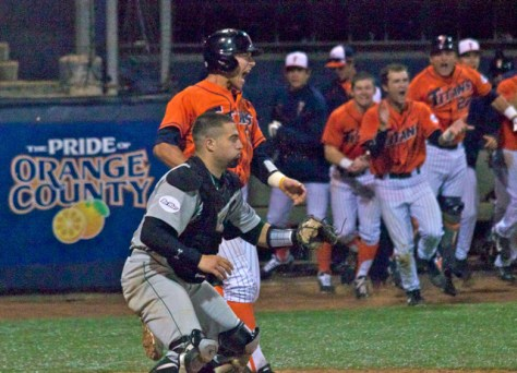 Jared Deacon jumps in excitement as the dugout pours out. (Photo: Shotgun Spratling)