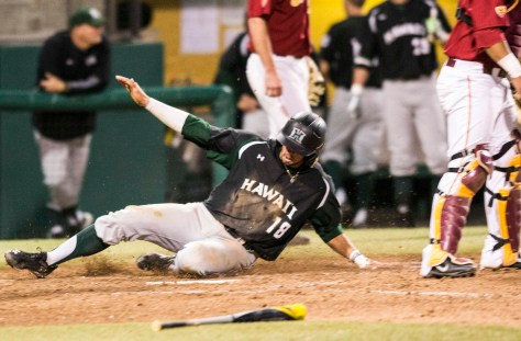 Austin Wobrock slides in with a run. (Photo: Mark Alexander)