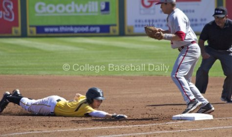 Garrett Hampson's dive back to first comes up short.