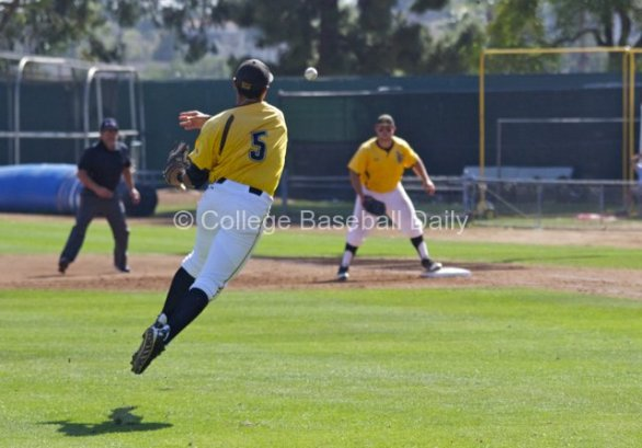 Alex DeGoti makes an off-balanced throw on a bunt.
