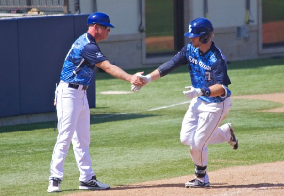 Josh Goossen-Brown is congratulated after a homer.