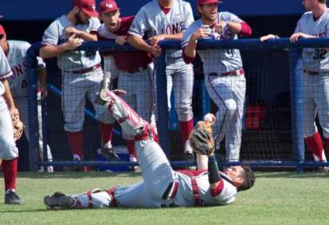 Kevin Garcia shows the ball after a diving catch on a bunt attempt.