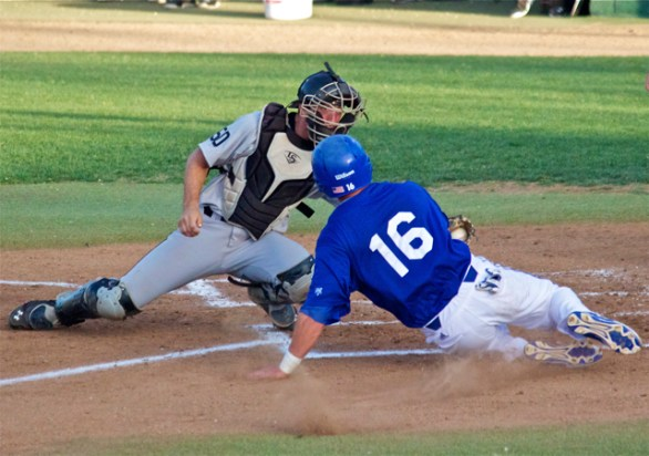 Eric Hutting applies the tag on Cody Hough. (Photo: Shotgun Spratling)
