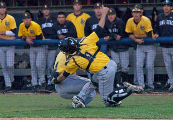 Alex Bishop and Ino Patron collide on a popped up bunt attempt.