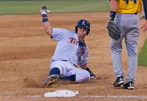 J.D. Davis slides into third base.