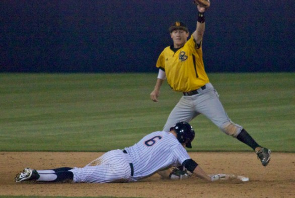 Garrett Hampson takes a pickoff attempt at second base.