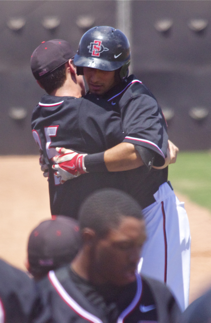 Michael Cederoth gives Seby Zavala a bear hug after his sac fly. (Photo: Shotgun Spratling)