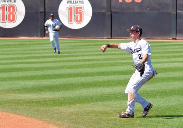 Justin Jones flips a ball to first to get Greg Allen. (Photo: Shotgun Spratling)