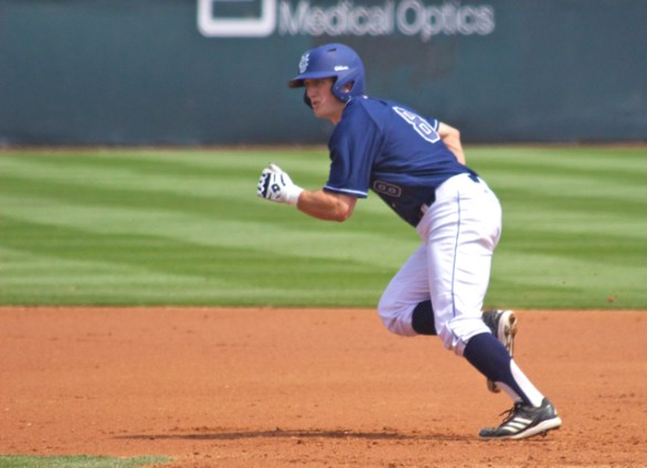 Evan Cassolato takes off from first base.