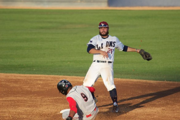 Brice Savage turns a double play. (Photo: Shotgun Spratling)
