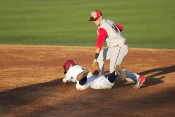 Tyler Cohen dives in with a stolen base. (Photo: Shotgun Spratling)