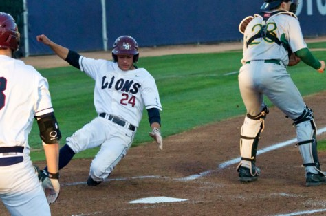 David Fletcher slides in with an LMU run. (Photo: Shotgun Spratling)
