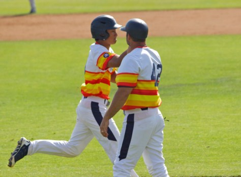 Kolten Yamaguchi is congratulated after his HR. (Photo: Shotgun Spratling)