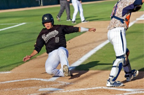 Chris Hoo slides in with the game's first run. (Photo: Shotgun Spratling)