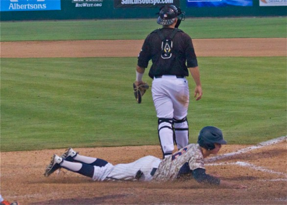 Hutton Moyer dives in with the go-ahead run. (Photo: Shotgun Spratling)