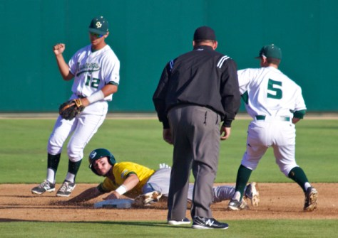 Mark Mathias gives a fist pump after Kyle Moses is tagged out. (Photo: Shotgun Spratling)
