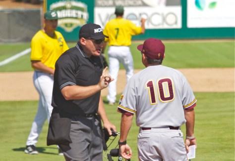 The umpire wants to hear none of Tim Esmay's argument. (Photo: Shotgun Spratling)