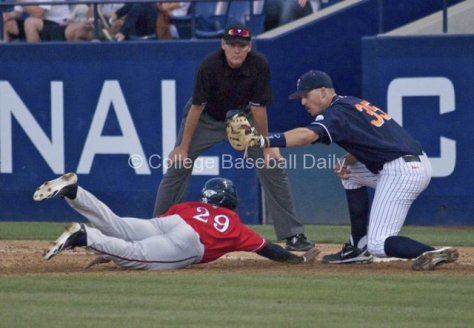 Tanner Pinkston goes to tag the runner.