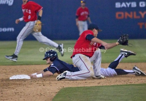 Keegan Dale dives in with a stolen base.