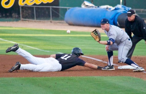 Connor Spencer tries to tag out Richard Prigatano. (Photo: Shotgun Spratling)