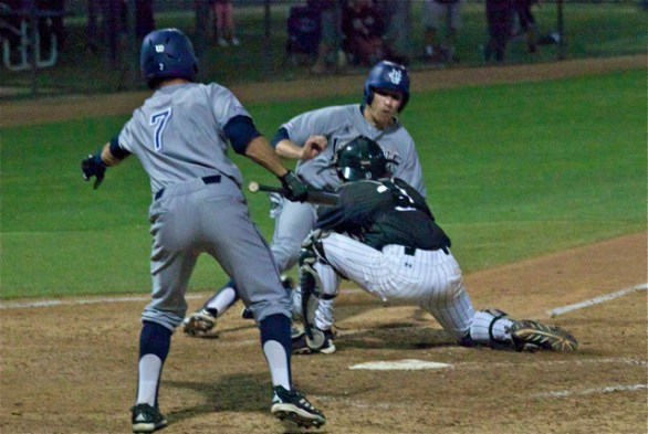 Taylor Sparks is hosed at the plate on a double steal attempt. (Photo: Shotgun Spratling)