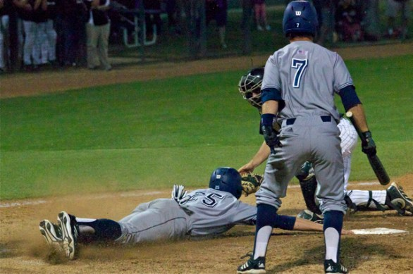 Taylor Sparks reaches back for the plate after being tagged. (Photo: Shotgun Spratling)