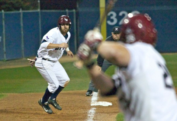 Cole Trezek leads off after one of LMU's three triples. (Photo: Shotgun Spratling)