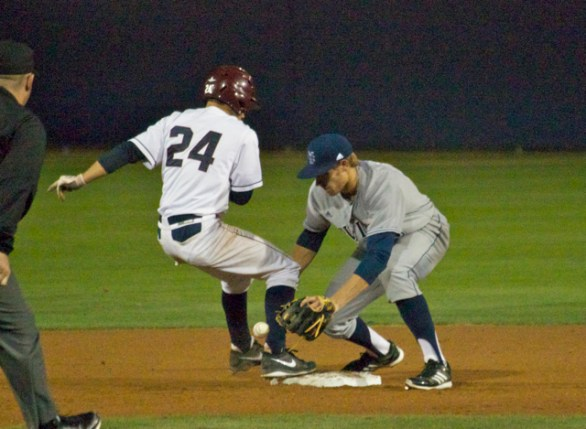 Taylor Sparks can't come up with a pickoff attempt. (Photo: Shotgun Spratling)