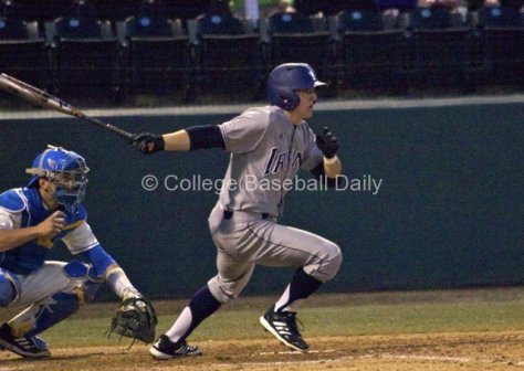 Evan Cassolato grounds one up the middle.