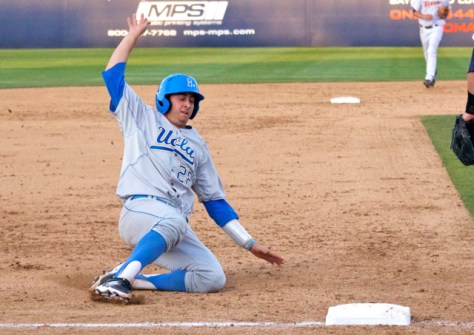Justin Hazard slides into third base. (Photo: Shotgun Spratling)