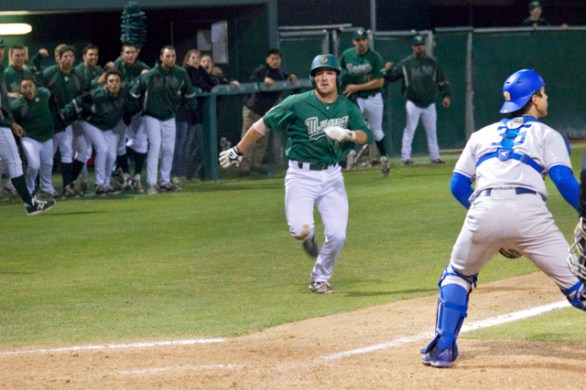 Brett Barbier heads home as the dugout gets ready to explode. (Photo: Shotgun Spratling)