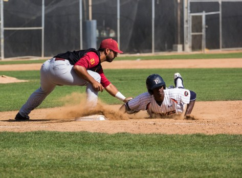 Manny Jefferson dives back to first base. (Photo: Mark Alexander)