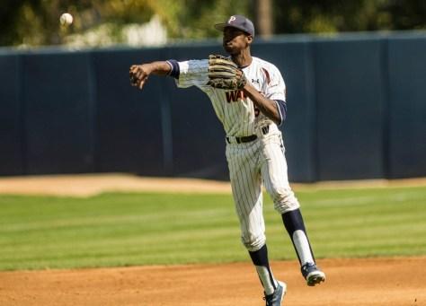 Manny Jefferson makes a one-legged throw. (Photo: Mark Alexander)