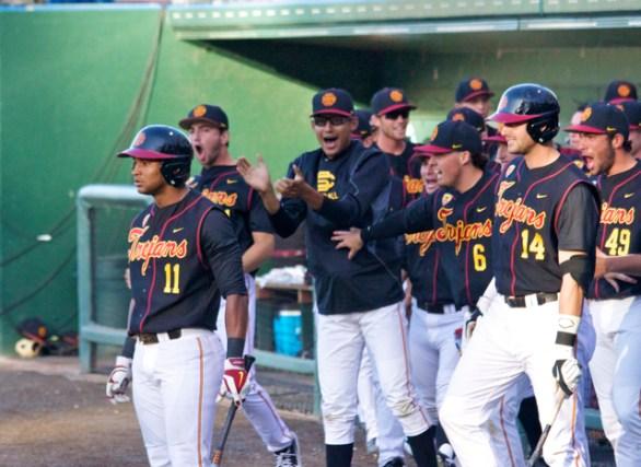 USC's dugout celebrates Robinson's HR. (Photo: Shotgun Spratling)