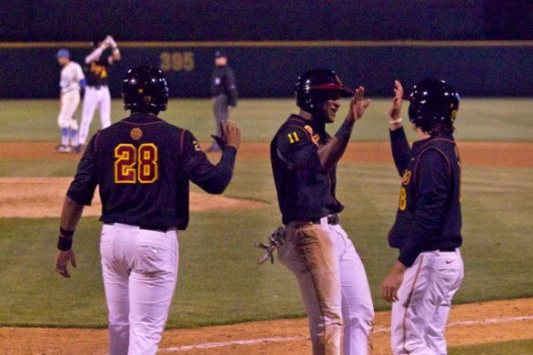 The Trojans celebrate a bases-clearing double. (Photo: Shotgun Spratling)