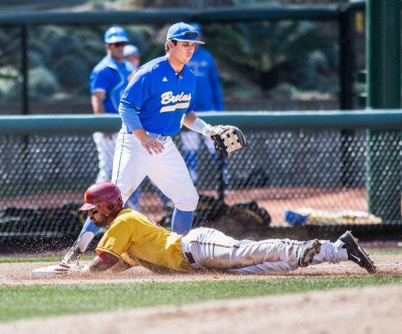Jake Hernandez dives into third base. (Photo: Mark Alexander)