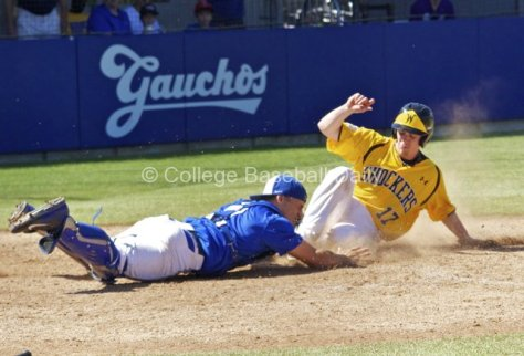 Tyler Baker slides in ahead of Jackson Morrow's ball-less tag.