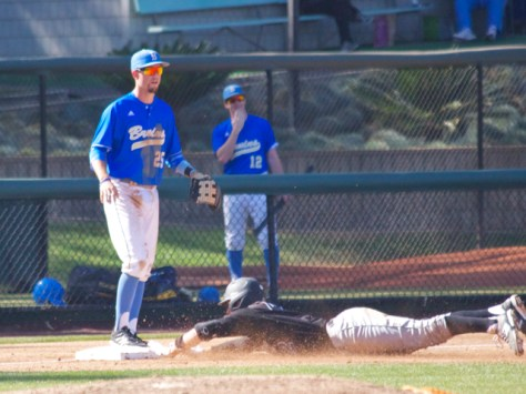 Zack Zehner dives into third.