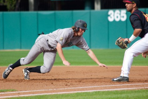 Tim Wise dives back to first.