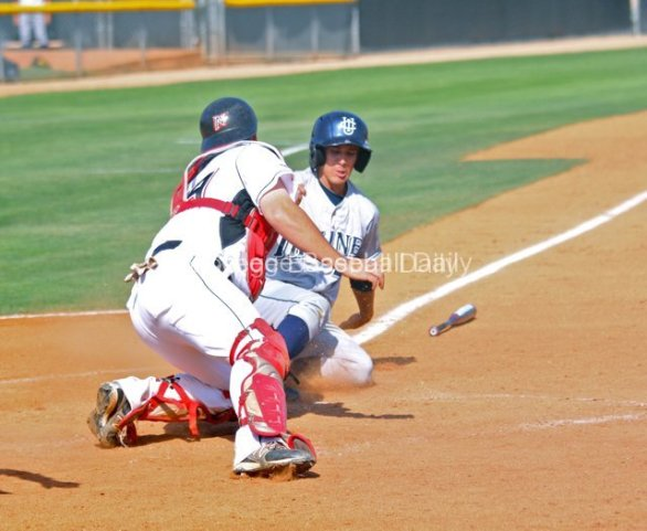 Tommy Reyes slides in before Bowen can get the tag.