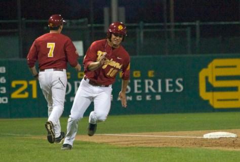 A.J. Ramirez races around third base.