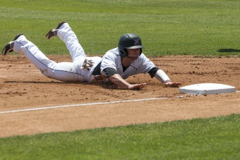 Michael Livingston dives into third base.