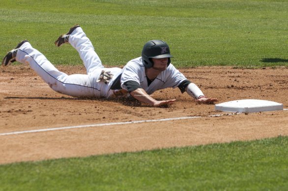 Michael Livingston dives into third base.