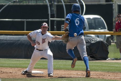 Josh Goossen-Brown stretches for a throw.