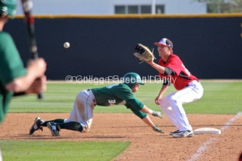 William Colantono takes the throw as Kade Andrus dives back in to first.