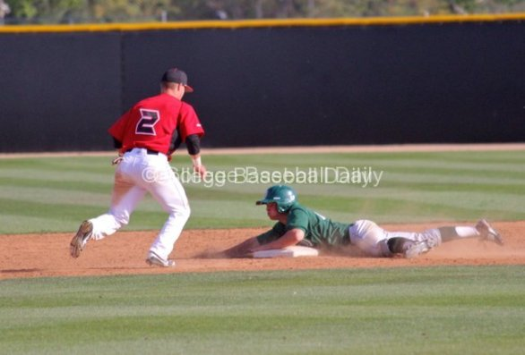 Mark Kreuger dives into second base. He had three hits.