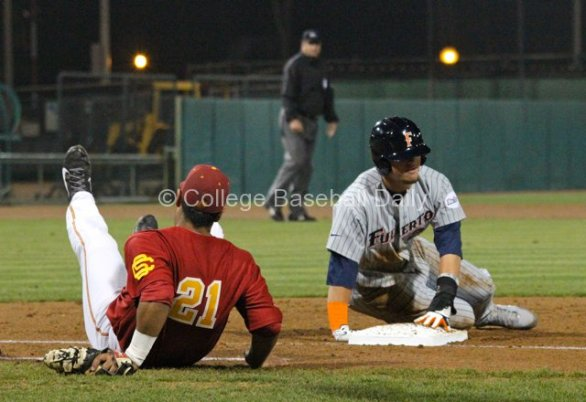 Jake Hernandez is knocked over by J.D. Davis diving back.